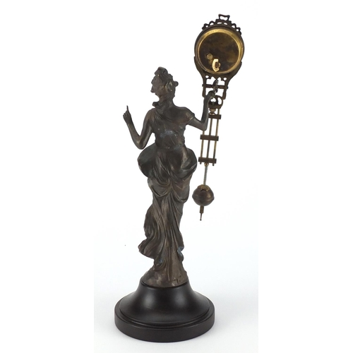 2165 - Patinated Spelter swinging mantel clock in the form of an Art Nouveau female, the clock by Junghans ...
