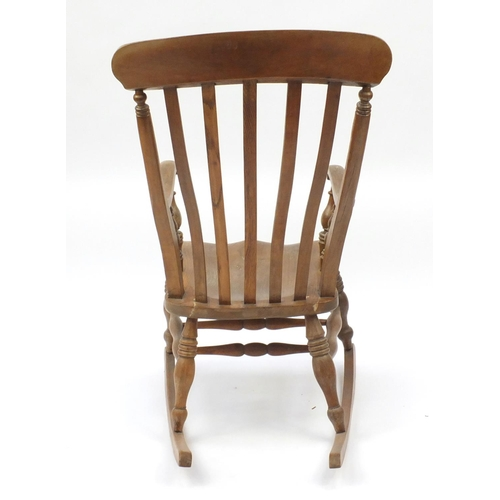 18 - Elm slat back rocking chair, 103cm high...