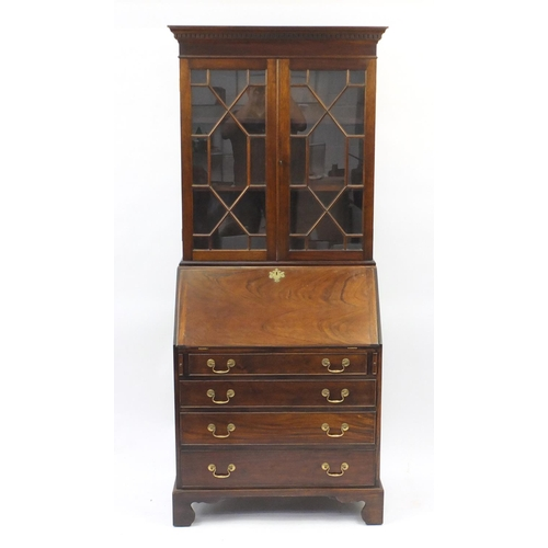 12 - Bureau bookcase fitted with a pair of astragal glazed doors enclosing two shelves, above a fall with...