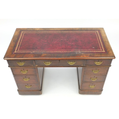 1 - Mahogany twin pedestal desk with tooled leather inset and fitted with nine drawers,  75cm H x 120cm ...