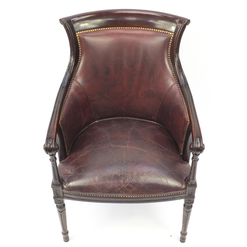 2013 - Mahogany and brown leather library chair on tapering legs, 91cm high...