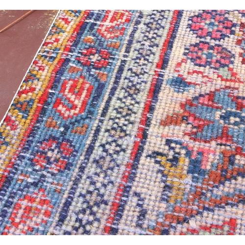 2015 - Rectangular Persian Sarough rug having an all over floral design onto a red ground, 300cm x 265cm...