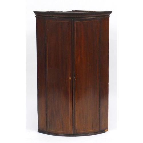 45 - Edwardian inlaid mahogany bow front corner cupboard, fitted with two shelves, 98cm H x 61cm W x 43cm...