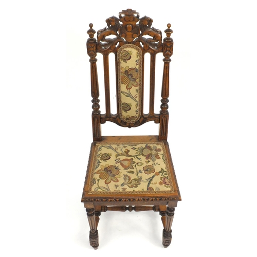 2 - Oak occasional chair carved with a lion crest and needlepoint upholstery, 113cm high...