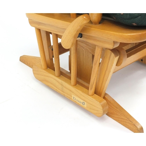 42 - Dutailier light oak rocking chair...