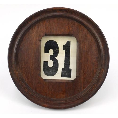 42 - Large Edwardian oak roller calendar, 41cm in diameter...