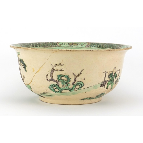 408 - Chinese famille verte pottery bowl, decorated in low relief with figures in a palace setting, six fi...