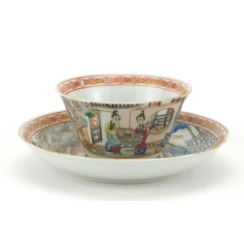 393 - Chinese porcelain tea cup and saucer, finely hand painted in the famille rose palette with figures i...