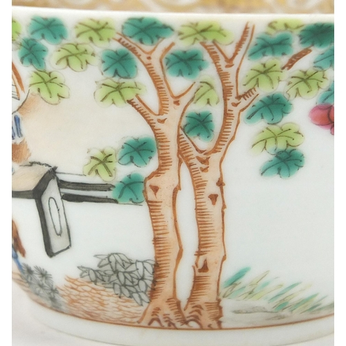 405 - Chinese porcelain tea cup and saucer, hand painted in the famille rose palette with figures in a pal...