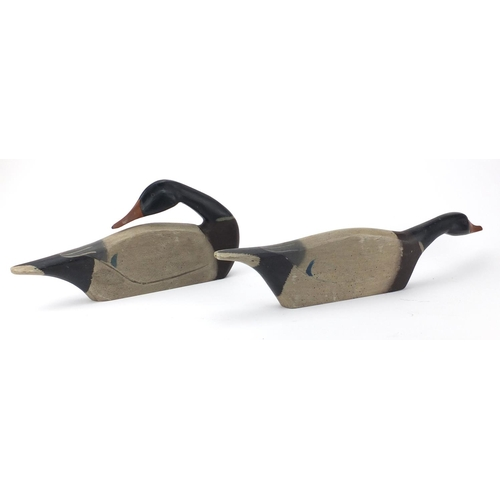 27 - Two James Haddon carved wood mallard duck decoys, both hand painted, the largest 55cm in length...
