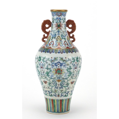 384 - Chinese porcelain doucai vase with iron red handles, finely hand painted with flower heads amongst f...