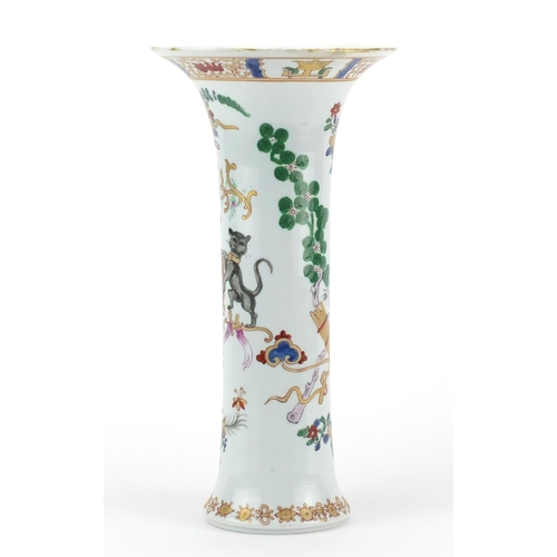 409 - Chinese porcelain trumpet vase, hand painted in the famille rose palette with an armorial crest and ...