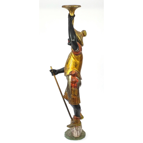11 - 19th century Venetian gesso and carved wood Blackamoor holding a torch aloft standing upon a gondola...