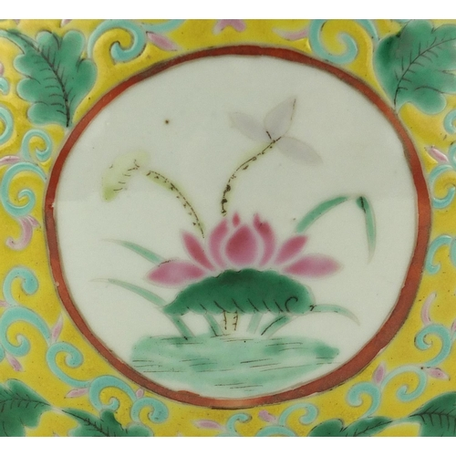 413 - Chinese porcelain fish bowl hand painted with panels of warriors within a foliate border onto a yell...