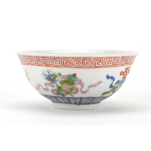 411 - Chinese porcelain footed bowl, hand painted in the famille rose palette with daoist emblems, iron re...