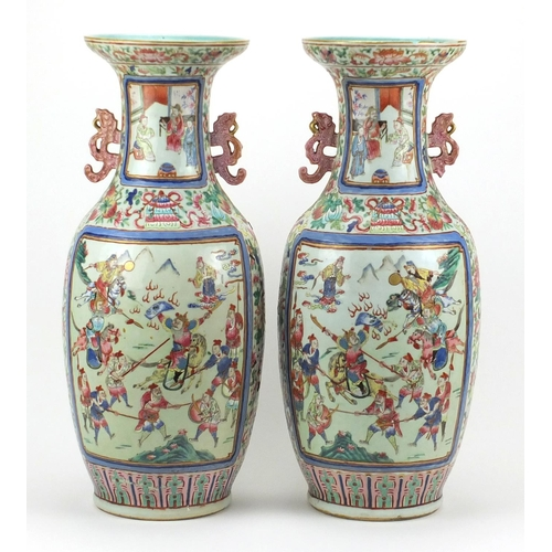 399 - Large pair of Chinese Canton porcelain vases with twin handles, each hand painted in the famille ros...