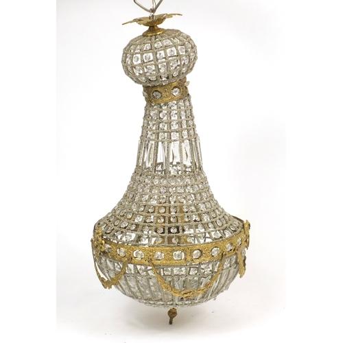 37 - Ornate gilt metal and glass chandelier, 76cm high...