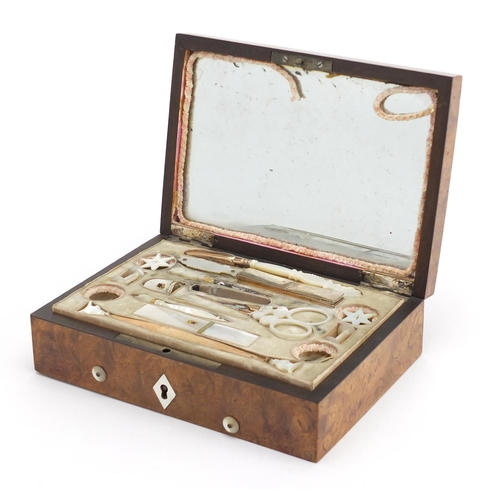 44 - 19th century French Palais Royal musical Necessaire with mother of pearl mounted implements and a go...