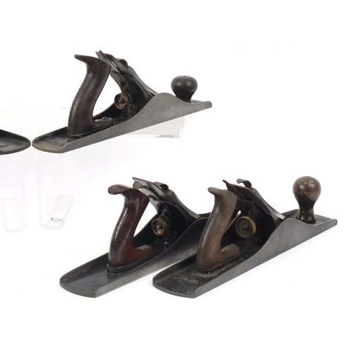 181 - Six vintage Stanley wood working planes comprising two No.5's, No.5a, two No.5½ and a No.G6...