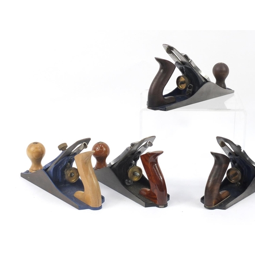 187 - Five vintage Record wood working planes comprising four No.04's and one No.04½...