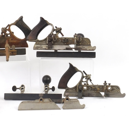 173 - Four vintage Stanley No.45 wood working combination planes, one with original crate...