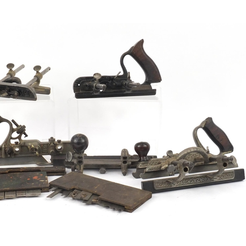 174 - Five vintage Stanley wood working combination planes comprising one No.45, one No.46 and three No.50...