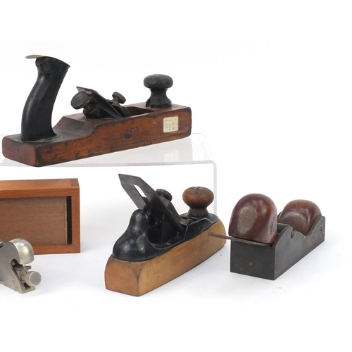 172 - Five vintage wood working planes including a Stanley 92 and Stanley No.122, the largest 25cm in leng...