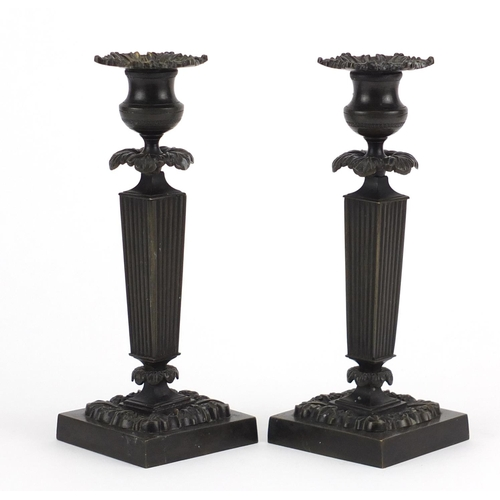 14 - Pair of 19th century classical patinated bronze candlesticks with tapering columns on square bases, ...