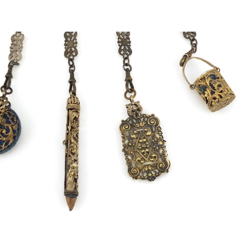 47 - 19th century gilt metal chatelaine with griffins, having five implements including aide memoire, pro...