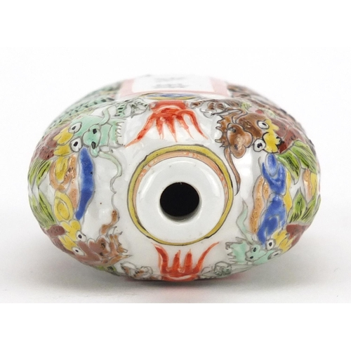 428 - Chinese porcelain relief snuff bottle, hand painted in the famille verte palette with dragons and ca...