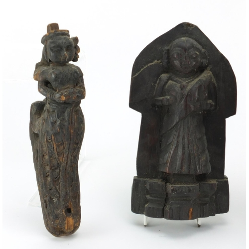 43 - Antique wood carvings including an 18th century Indian example of a robed figure and a lions head, t...