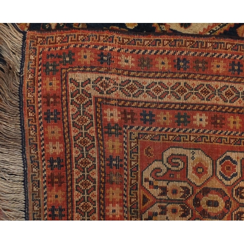 2032 - Rectangular Persian Kashgan rug, having and all over stylised design, 214cm x 138cm...