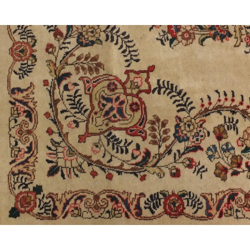 2043 - Rectangular Persian Tabriz carpet, the central field having foliate motifs onto an ivory ground with...