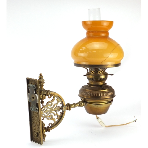 17 - Victorian ornate pierced brass wall bracket with Hinks patent oil lamp, with glass shade and funnel,...