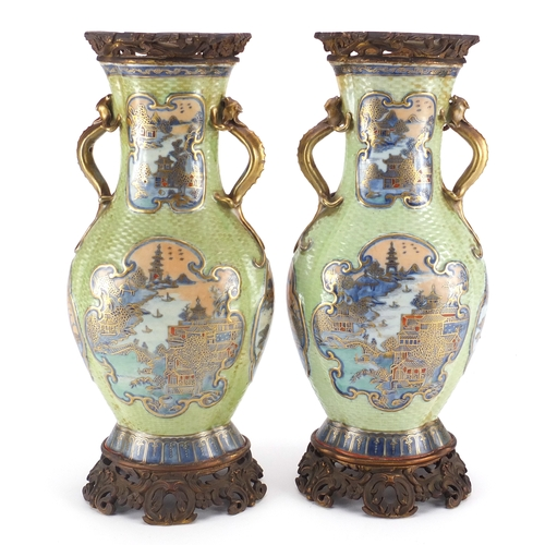 415 - Pair of Chinese porcelain green ground vases with gilt metal mounts and twin handles, each hand pain...