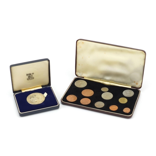 2800 - Elizabeth II 1968 specimen coin set and a silver Prince of Wales Investiture medal, approximate weig...