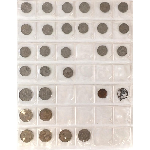 2807 - British coinage some pre 1947, mostly arranged in and album including shillings, two shillings, flor...