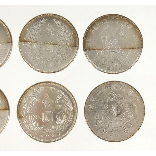2813 - Six Chinese silver coloured dollars, approximate weight 160.0g...