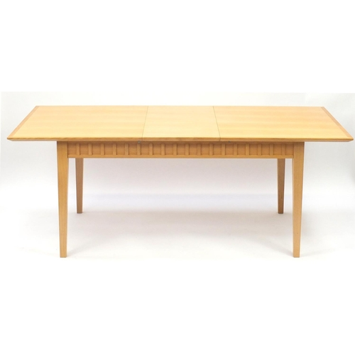 2024 - Contemporary light oak extending dining table with extra leaf and four chairs, the table 76cm H x 20...
