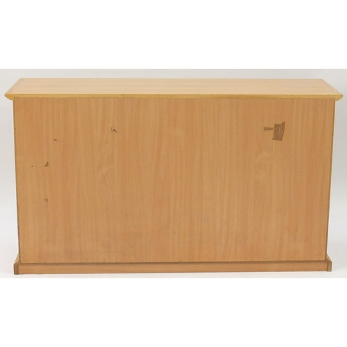 2025 - Contemporary light oak sideboard fitted with four drawers and a pair of cupboard doors, 85.5cm H x 1...