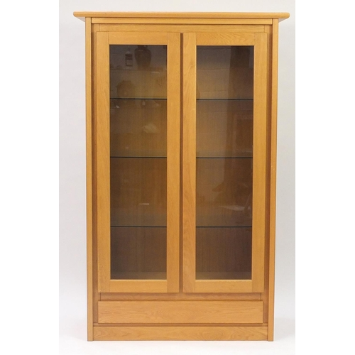 2036 - Contemporary light oak display cabinet fitted with three glass shelves and base drawer, 180cm H x 11...