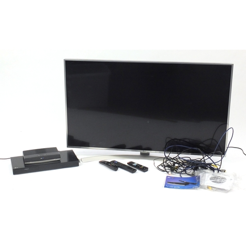 2058 - LG 49inch LED television, LG Ultra HD DVD player and a BT you view box, with remote controls...
