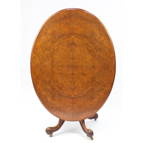 2005 - Victorian quarter veneered walnut snap top loo table, with carved column and scroll feet 77cm H x 15...