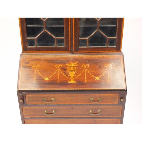 2017 - Edwardian mahogany bureau bookcase inlaid with urns and swags, fitted with a pair of astragal glazed...