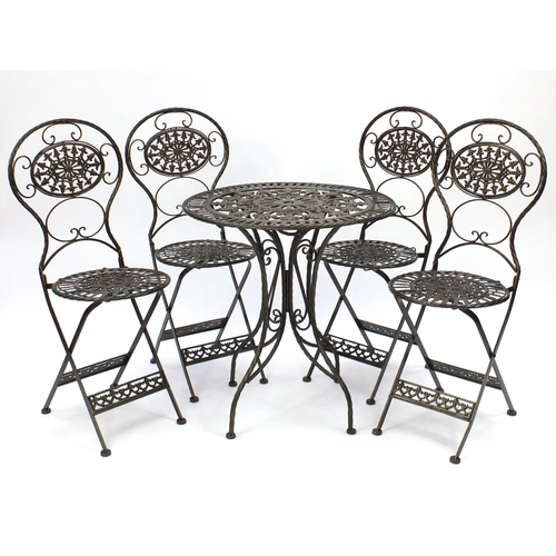 2030 - Gold painted wrought iron garden table with four folding chairs, the table 73cm high x 70cm in diame...