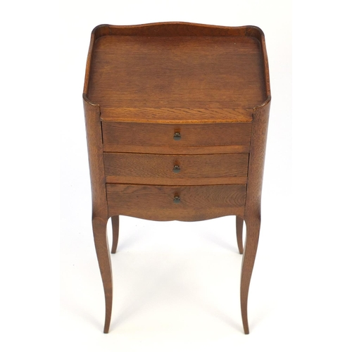 2031 - French oak side table fitted with three drawers raised on cabriole legs, 70cm H x 34cm W x 26cm D...