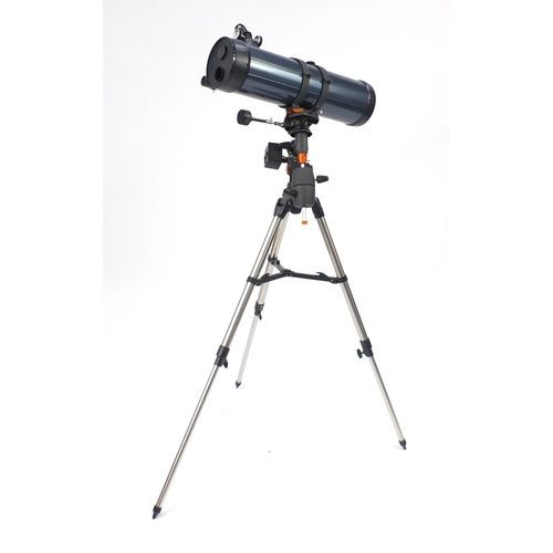 2035 - Celestron Astro Master motorised telescope on tripod stand with accessories, model 130EQ...