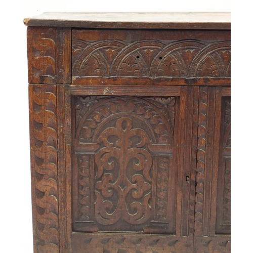 2042 - Antique oak side cabinet, with arcadian carved drawer above a pair of  carved cupboard doors, 82cm H...