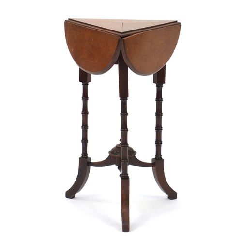 2045 - Victorian walnut and mahogany club shaped folding occasional table, raised on simulated bamboo legs,...