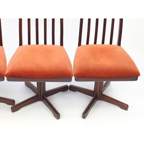 2057 - Set of eight Vintage Rosewood swivel dining chairs, reputably retailed by Waring & Gillow, each 103c...